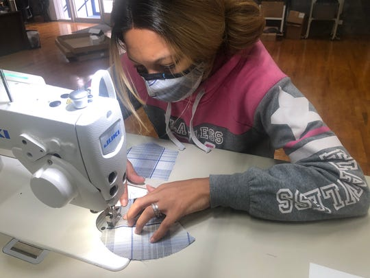Laiisha Biddle, a skilled maker at Kitsbow Cycling Apparel, works on a face mask this week. The Old Fort-based company has switched from manufacturing bike apparel to PPE in light of the coronavirus pandemic.