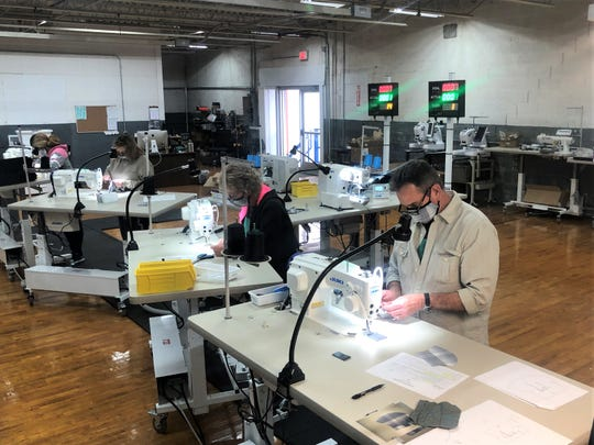Employees at Kitsbow Cycling Apparel in Old Fort work on making face masks for medical workers and first responders. The company has switched from manufacturing bike apparel to PPE in light of the coronavirus pandemic.