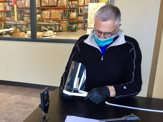 Tom Dempsey, president of Brevard-based SylvanSport, which makes camping and gear trailers, has switched his manufacturing plant to producing PPE, including face shields, to help health care workers during the coronavirus pandemic.