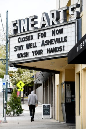 """Few people walked in downtown Asheville March 25, 2020, the day Buncombe County issued a declaration ordering residents to stay home in an effort to slow the spread of COVID-19. The """"Stay home, stay safe"""" measure goes into effect at 8 p.m. March 26 and lasts through 6 a.m. April 9."""