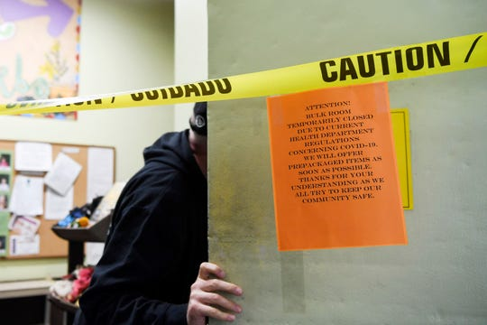 The French Broad Co-Op has taken measures to help prevent the spread of coronavirus, like closing its bulk food room to the public, while keeping its doors open on French Broad Ave in downtown Asheville March 25, 2020.