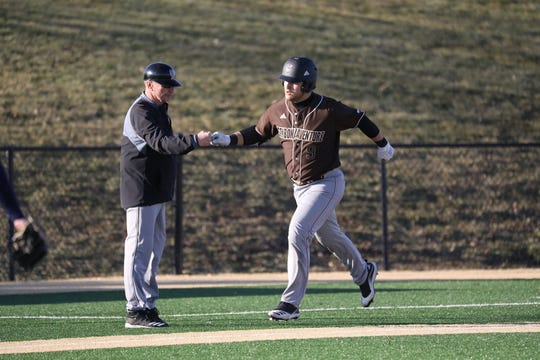St. Bonaventure's Brendyn Stillman is congratulated by coachh Larry Sudbrook after hitting a home run earlier this season.