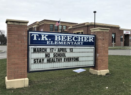 """A """"closed"""" sign in front of Beecher Elementary School at the corner of Sullivan and Church streets in Elmira."""