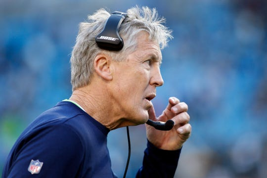 FILE- In this Dec. 15, 2019, file photo, Seattle Seahawks coach Pete Carroll watches from the sideline during the second half of the team's NFL football game against the Carolina Panthers in Charlotte, N.C. This fall, all four teams from one division could theoretically make the playoffs. If any division is going to do it, the NFC West certainly seems to have the best chance, based on these four teams' recent body of work and their prospects for the year ahead. (AP Photo/Brian Blanco, File)