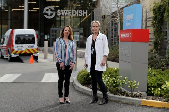 Melissa Short, left, system executive director for women's health at Swedish Medical Center, and Dr. Tanya Sorensen, a practicing maternal-fetal medicine physician at Swedish and executive director for women's services, pose in front of the center in Edmonds. Several dozen expectant moms who had planned to give birth at the birth unit of the center will now have to go elsewhere because the facility is being repurposed to treat victims of the new coronavirus.