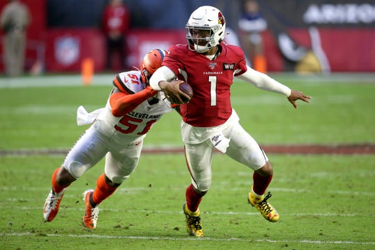 FILE - In this Dec. 15, 2019, file photo, Arizona Cardinals quarterback Kyler Murray (1) gets away from Cleveland Browns linebacker Mack Wilson (51) during the second half of an NFL football game in Glendale, Ariz. Coach Kliff Kingsbury and the Cardinals went 5-10-1 last year, but they're a popular pick to improve sharply this year.