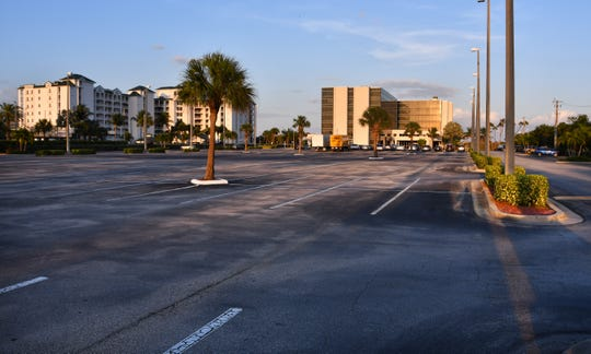 The parking lot at the Cocoa Beach Hilton is almost empty.