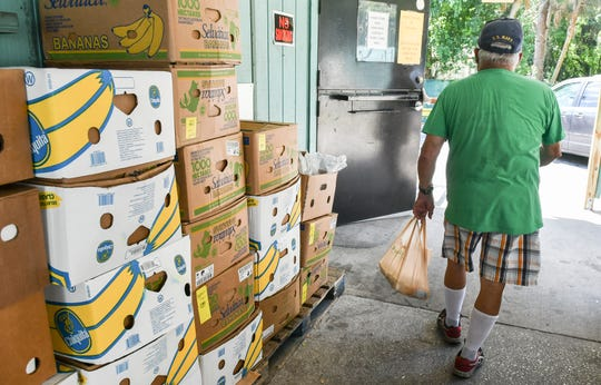 Jim Scobie, 73, leaves after receiving a meal at the Central Brevard Sharing Center in Cocoa.