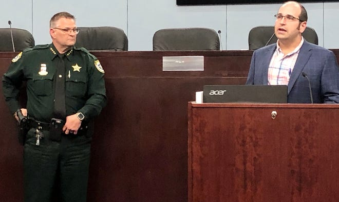 Brevard County Sheriff Wayne Ivey and Brevard County Commission Chair Bryan Lober discuss the beach closing issue at a news conference Thursday afternoon at the Brevard County Government Center in Viera.