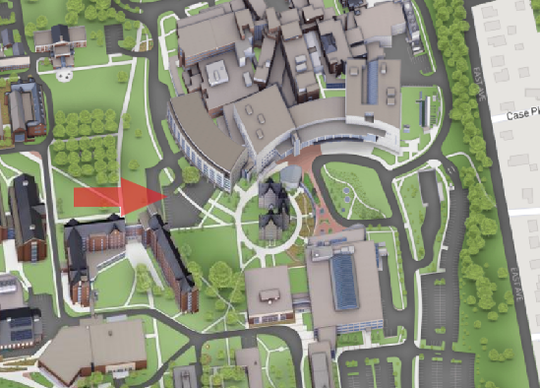 Parking lot for UVM's Converse Hall (indicated by orange arrow)  is temporarily being used by the hospital (at right) for cornavirus testing, the UVM Medical Center announced March 25, 2020.