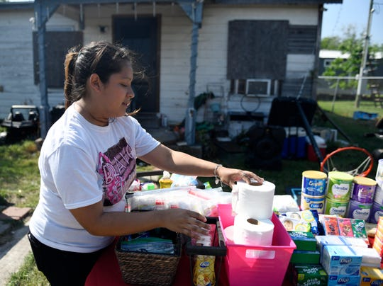 Lucy Naranjo sets up her Blessings Table in her front lawn, Thursday, March 26, 2020, in Taft. Naranjo and her husband, Arturo, have had the table in their yard for four days in reaction to the coronavirus.