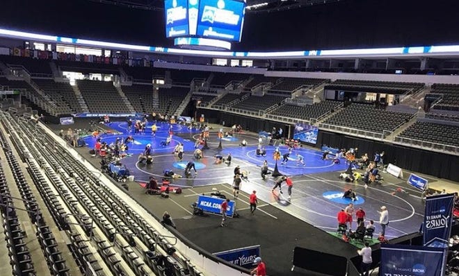 Division II wrestlers work out on the mats in Sioux Falls, S.D., on March 12, the day before the NCAA Championships were scheduled to begin.