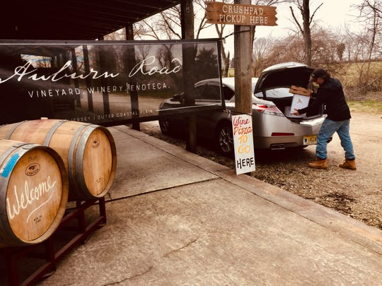 Scott Donnini of Auburn Road Vineyard fills a customer's trunk with their wine order. Wineries across New Jersey are offering curbside pickup and delivery during the coronavirus pandemic.