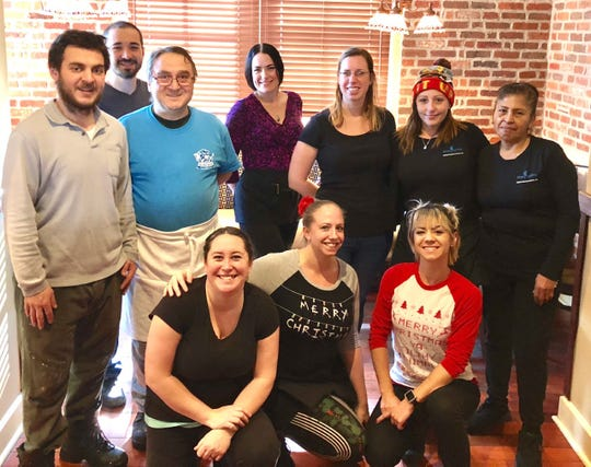 Staff at Blue Monkey Tavern pose for a photo during the holidays.