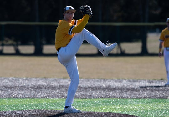 Rowan senior Drew Ryback, a Clearview graduate, gets ready to pitch.