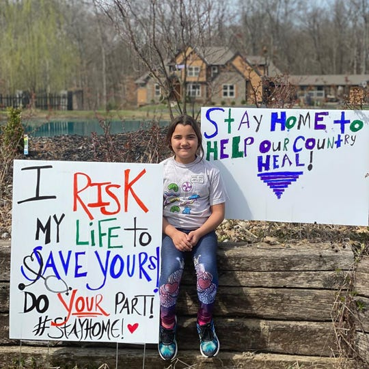 Alicia Scheffer's daughter, Giuliana, sits outside their home in Loveland.