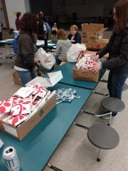 Volunteers from Dougie & Ray's help pack up donated Chick-fil-A to deliver to Fairfield City School District students.