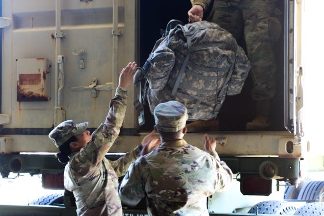 FORT CAMPBELL, Ky. – Soldiers assigned to the 531st Hospital Center and 586th Field Hospital load their gear and board a military transport aircraft headed for New York state, March 25.  These Soldiers constitute an advance party of Army medical professionals deploying to New York, ahead of the rest of the unit, in support of civil authorities and our nation's response to the COVID-19 pandemic.  The 531st is prepared to provide a full range of health care, and is ready to support as needed.