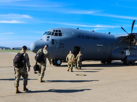 Soldiers assigned to the 531st Hospital Center and 586th Field Hospital board a military transport aircraft headed for New York on March 25, 2020. These soldiers constitute an advance party of Army medical professionals deploying to New York, ahead of the rest of the unit, in support of civil authorities and the U.S. response to the COVID-19 pandemic.