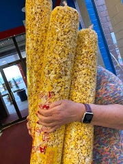 Shelby Theatres sold 1,000 bags of popcorn in two days to people in their cars as they drove through the Downtowner Plaza. The bags were $3 each, but many people donated more than that to the family ran business.