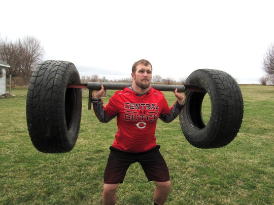 Central College junior defensive lineman Cody Wonderlich works out at his home in Pleasant Hill.