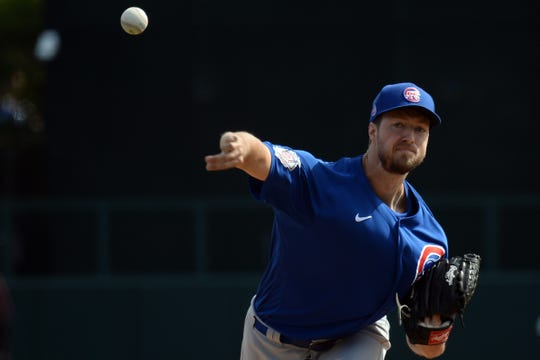 Chicago Cubs starting pitcher Colin Rea (20) pitches against the Los Angeles Dodgers during the second inning of a spring training game at Camelback Ranch.
