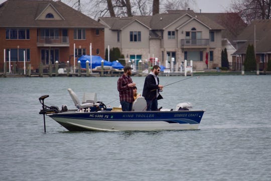Three men ride in their boat down Black Creek, which leads to Lake St. Clair, on Thursday, March 26, 2020, at Lake St. Clair Metropark in Harrison Township.