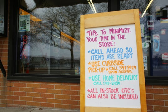 Suggestions for customers are left outisde of the Central Drug Store in downtown Charlevoix, one of the only store-fronts still open to customers.