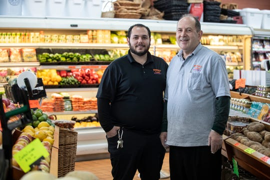 Kyle Shammami and his father Mark pose for a photo at Penny Lake Market in Walled Lake, Wednesday, March 25, 2020.