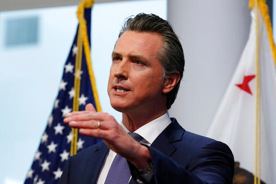 In this March 23, 2020, file photo California Gov. Gavin Newsom updates the state's response to the coronavirus at the Governor's Office of Emergency Services in Rancho Cordova, Calif.