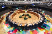 In this Feb. 21, 2020 file photo, European Union leaders meet at a round table during an EU summit in Brussels. European Union leaders are convening by video conference Thursday, March 26, 2020, for their third summit in three weeks, as they battle to contain the spread of the coronavirus.