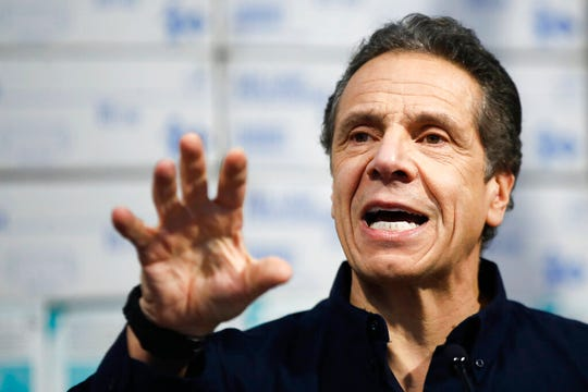In this March 24, 2020 photo, New York Gov. Andrew Cuomo speaks during a news conference at the Jacob Javits Center.