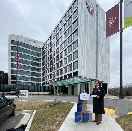 Zackery Zhang, MD, delivers medical supplies to the office of philanthropy at Mercy Health.