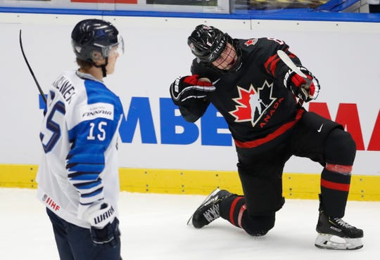 Canada's Jamie Drysdale, right, celebrates a goal against Finland in the semifinals of the U20 world championships in the Czech Republic. (Associated Press)