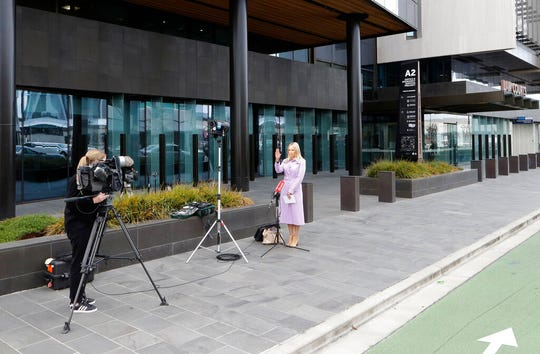 Media film outside the Christchurch High Court in Christchurch, New Zealand, Thursday, March 26, 2020. One year after killing 51 worshipers at two Christchurch mosques, an Australian white supremacist accused of the slaughter on Thursday changed his plea to guilty.