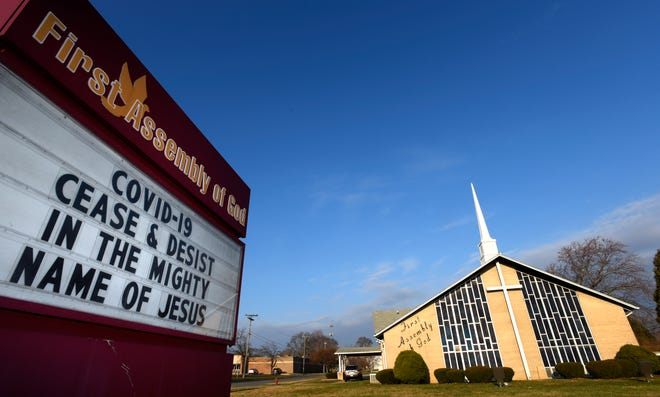 A COVID-19 prayer message on the marquee in front of the First Assembly of God church in Dearborn Heights, Thursday morning, March 26, 2020.