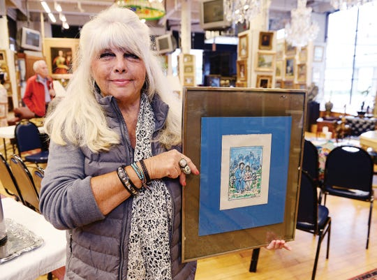 Maggie Klein with her print.
