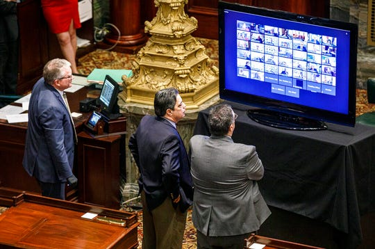 Senate Democratic Leader Jay Costa, D-Allegheny, center, stands near his chief of staff Tony Lapore, right, as they watch a monitor where a majority of senators have live-streamed the senate session, Wednesday, March 25, 2020, in Harrisburg, Pa