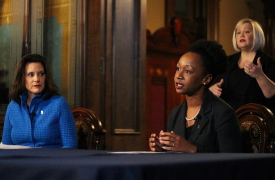Dr. Joneigh Khaldun, the state's chief medical executive, and Gov. Gretchen Whitmer speak during a press conference on Thursday, March 26, 2020, in Lansing. The two state officials were updating the public on the Michigan's response to COVID-19.