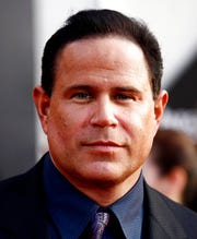 "This April 26, 2010 file photo shows actor Keith Middlebrook at the premiere of ""Iron Man 2"" at the El Capitan Theatre in Los Angeles.  The FBI has arrested Middlebrook, who officials said falsely claimed to have developed a cure for the coronavirus and solicited investments in a company he said would market the medication."