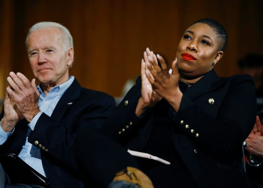 Democratic presidential candidate, former Vice President Joe Biden and senior adviser Symone Sanders participate in a campaign event Jan. 27, 2020, in Iowa City, Iowa.