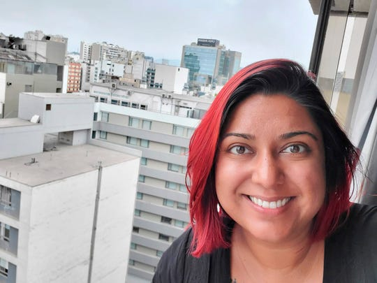 In this undated selfie provided by Jessica Brar, she looks out from her room at the Selina Miraflores Hostel in Lima, Peru.