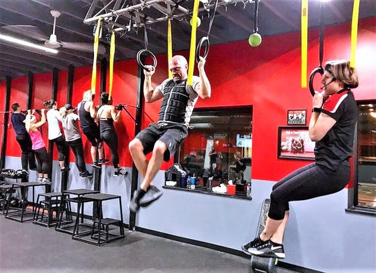 Members work out at the Journey Fitness 333 facility in Corning. Now that the coronavirus outbreak has forced gyms to close, Journey Fitness and other outlets are offering online activities and coaching.