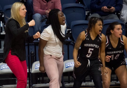 University of Indianapolis women's basketball assistant coach and defensive coordinator FahKara Malone, center, cheers on her team as the Greyhounds play the University of Southern Indiana Screaming Eagles at Screaming Eagles Arena in Evansville, Ind., Saturday afternoon, Feb. 29, 2020.