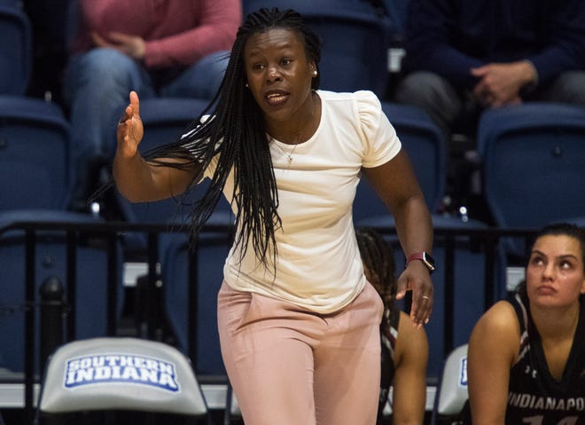 University of Indianapolis women's basketball assistant coach and defensive coordinator FahKara Malone, center, calls out a play as the Greyhounds play the University of Southern Indiana Screaming Eagles at Screaming Eagles Arena in Evansville, Ind., Saturday afternoon, Feb. 29, 2020.
