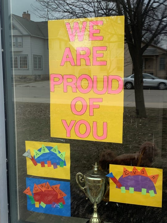 At Riverside Elementary School, instructional aides created posters and placed student artwork in the windows to let students know the staff is thinking about them.