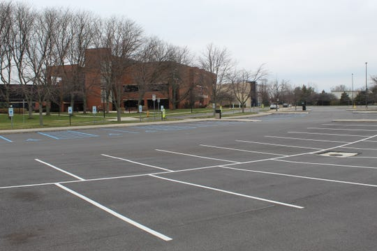 Terra State Community College's parking lot is empty after the school resumed classes online-only starting Monday. All classrooms, on-campus labs, student services, computer labs, offices, and the conference center remain closed due to the coronavirus pandemic.
