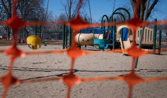 The playground is closed at City Park as Larimer County issues a stay-at-home order in Fort Collins, Colo. on Thursday, March 26, 2020.