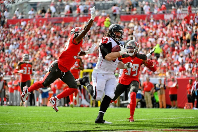 Dec 29, 2019; Tampa, Florida, USA; Atlanta Falcons offensive tackle Ty Sambrailo (74) runs for a touchdown against the Tampa Bay Buccaneers during the first half at Raymond James Stadium. Mandatory Credit: Jasen Vinlove-USA TODAY Sports