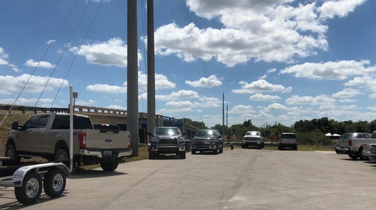 The Alva post office lot became satellite parking for all the people enjoying the river last weekend.
